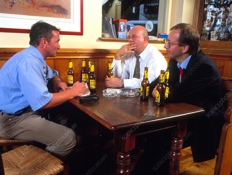 Men drinking alcohol in a bar