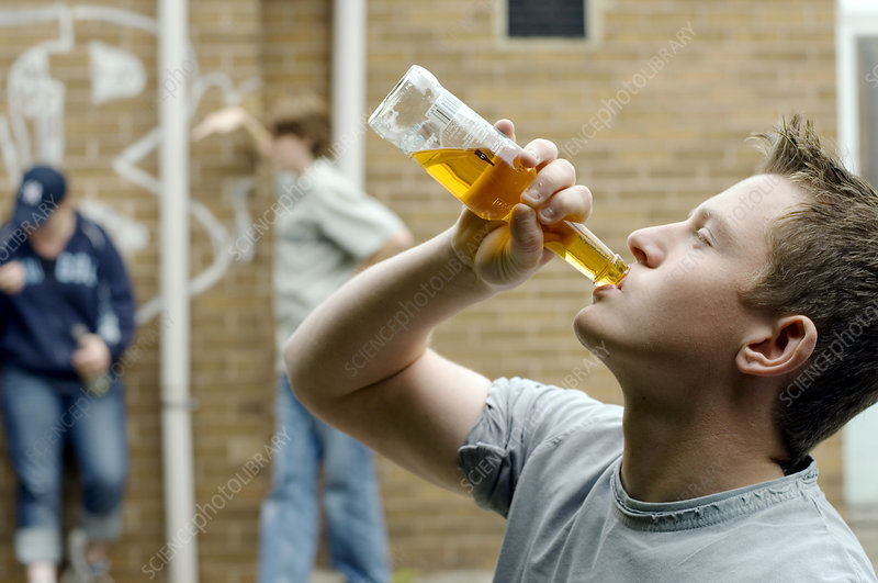 Teenage boy drinking alcohol