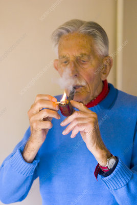 Elderly man smoking a pipe