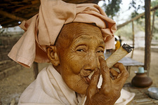 Buddhist Nun Smoking Cheroot