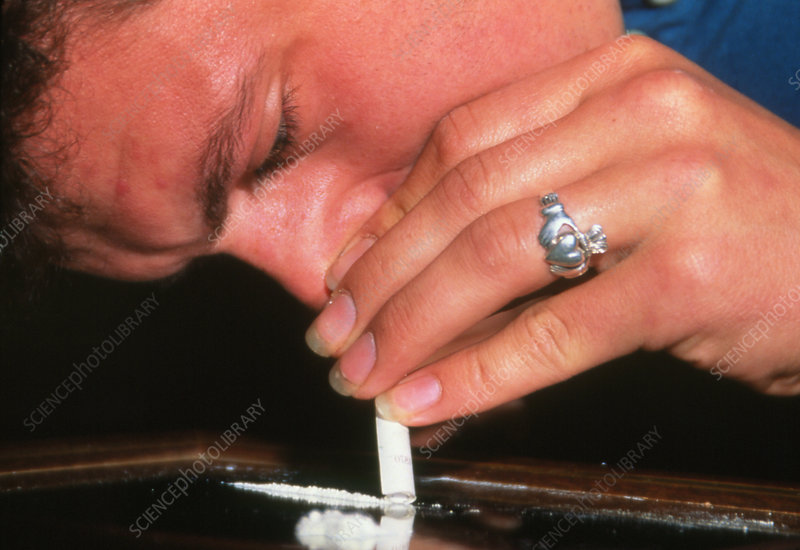 Man snorting a line of cocaine