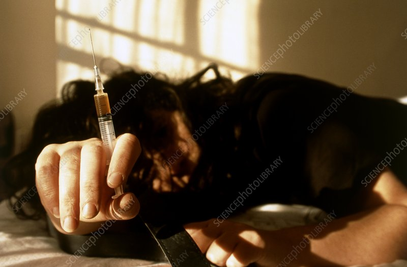 Heroin user slumped after injecting the drug