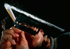 Woman snorting a line of cocaine seen from below