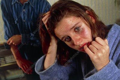 Fearful woman during an assault by her partner