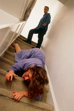 Woman being pushed downstairs by her partner