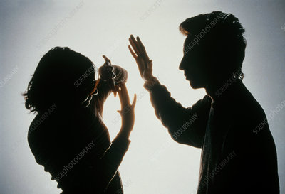 Silhouette of a man striking a woman