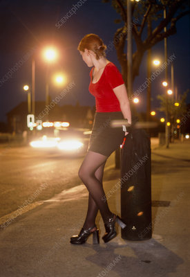 Child prostitute soliciting by a roadside