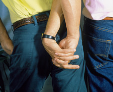 Homosexuality: two men hold hands