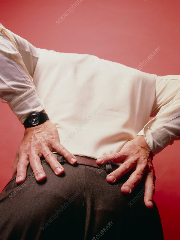 An elderly man experiencing lower back pain