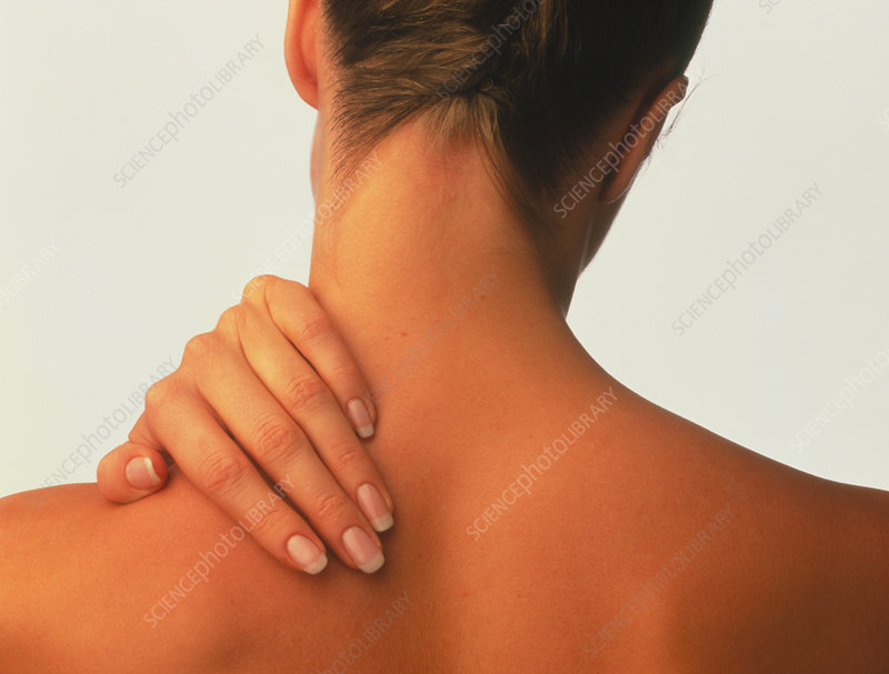 Neck pain: hand of a woman holding her neck
