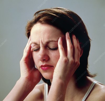 Young woman suffering a headache or migraine