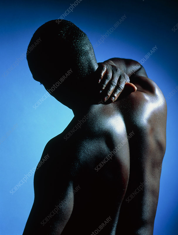 Neck/shoulder pain: black man with hand on neck