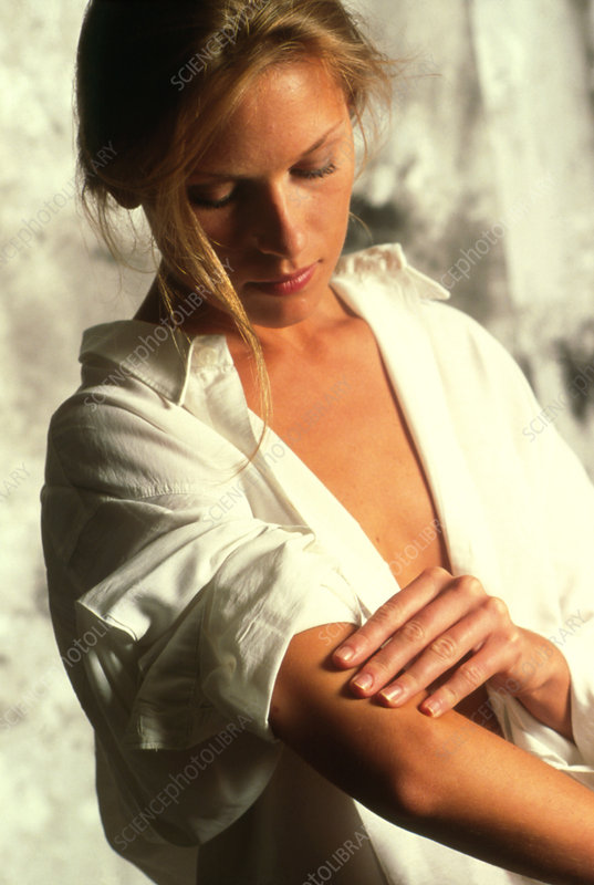 Woman holding her painful elbow