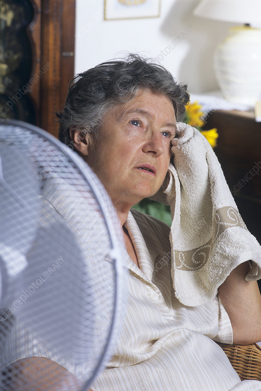 Elderly woman cooling herself