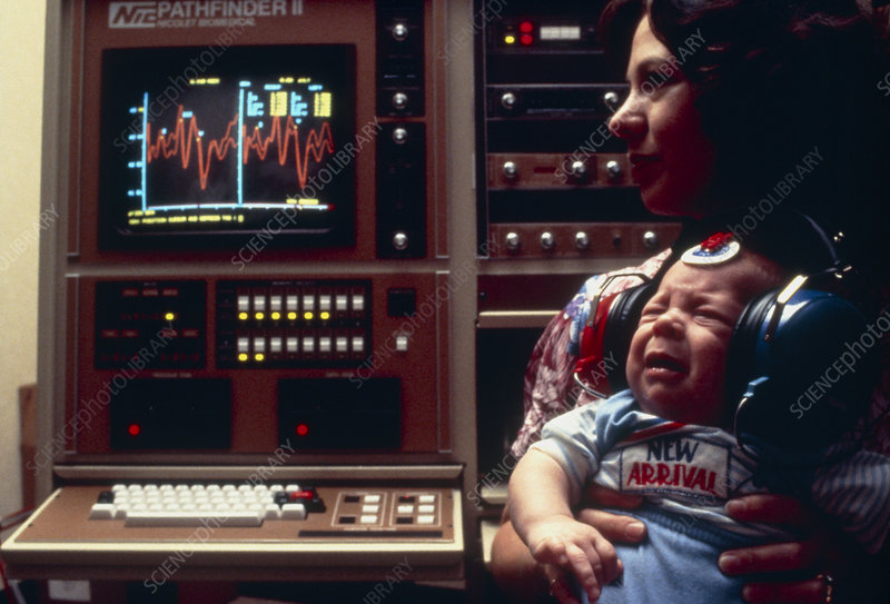 Infant undergoing tests for hearing impairment