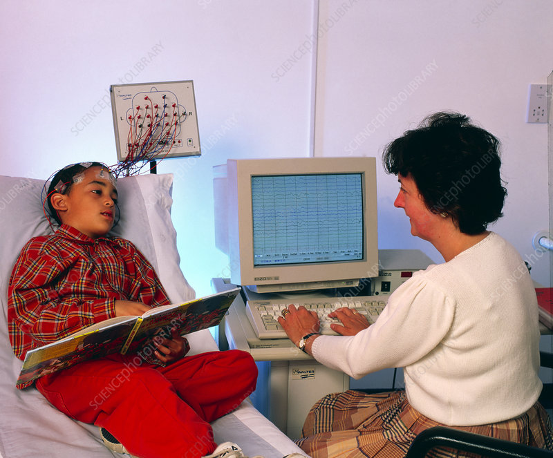 Doctor monitors boy's brain activity by EEG