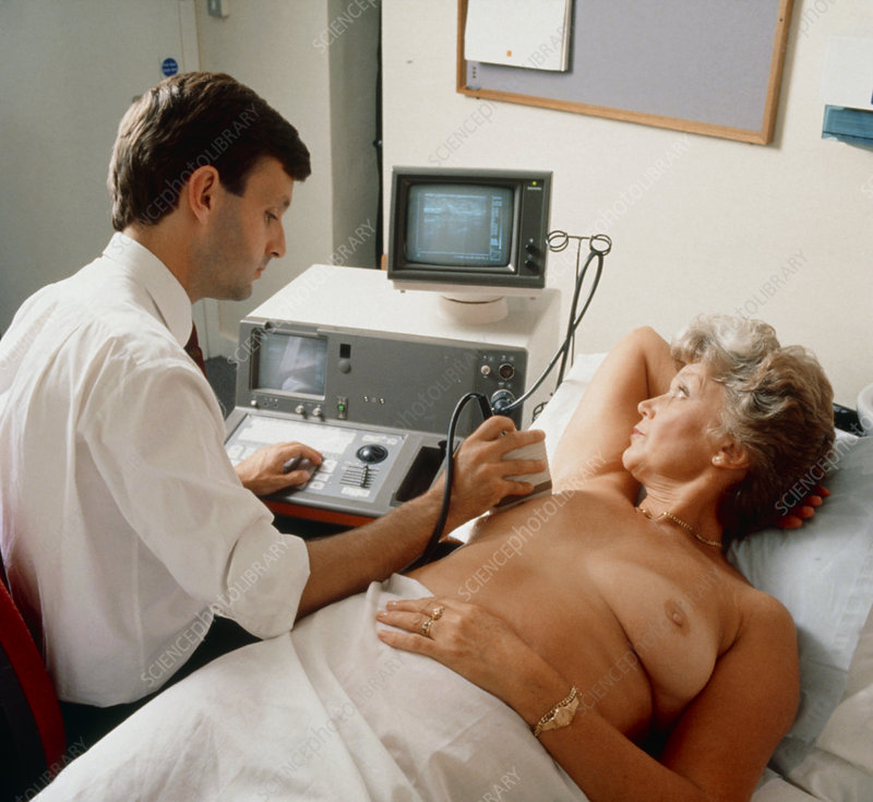 Ultrasound breast examination being performed