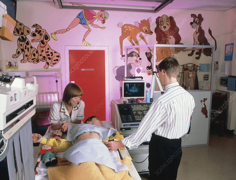 Young girl undergoing an abdominal ultrasound scan