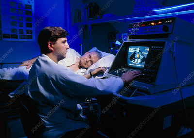 Doctor performing echocardiography on patient