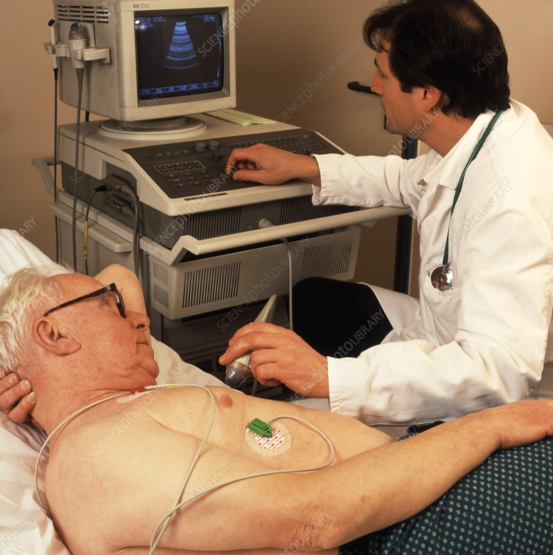 Heart ultrasound scan being conducted on a man