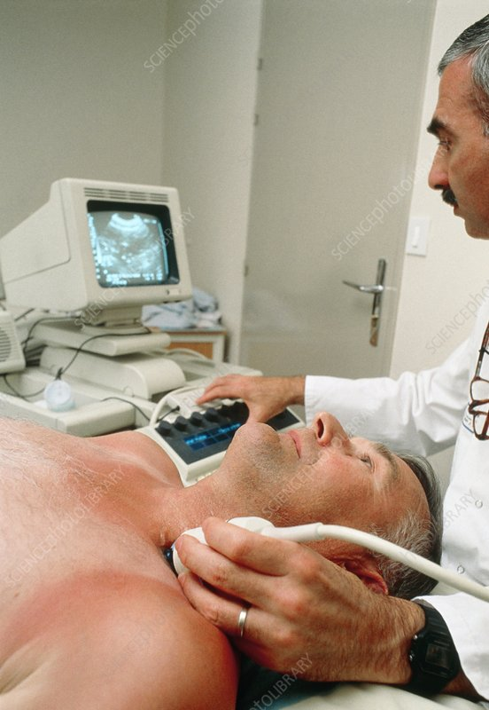 Scanning a man's artery using doppler ultrasound