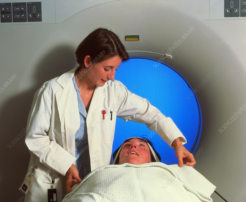 Radiologist prepares patient for a CT brain scan