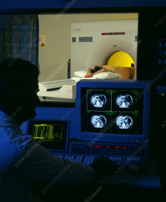 Patient undergoing CT scan seen from control room