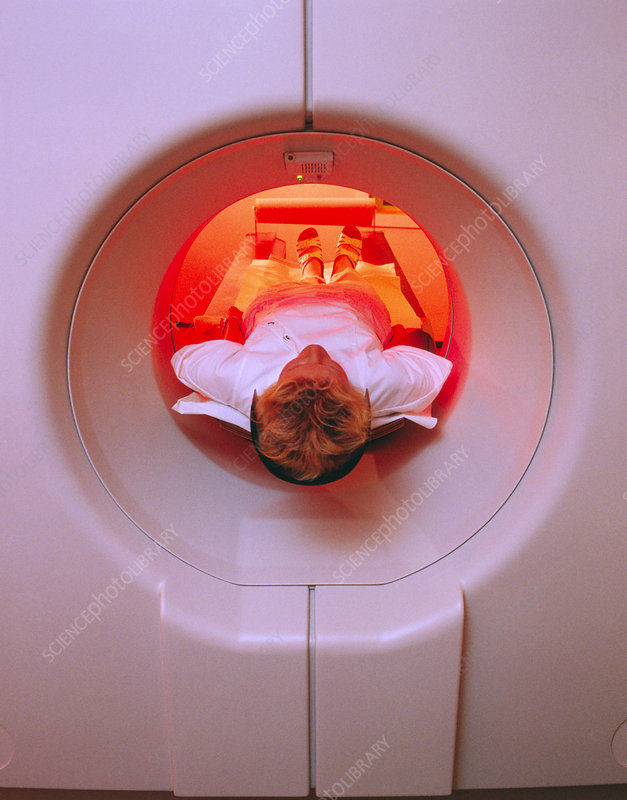 Female patient undergoing an upper-body CT scan