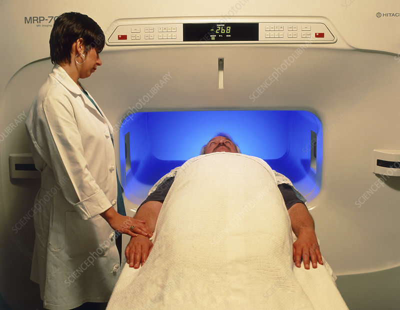 Man in wide MRI scanner for claustrophobics