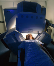Woman's head being scanned by a gamma camera