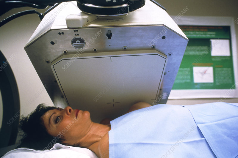 Woman undergoing gamma scanning of her breast