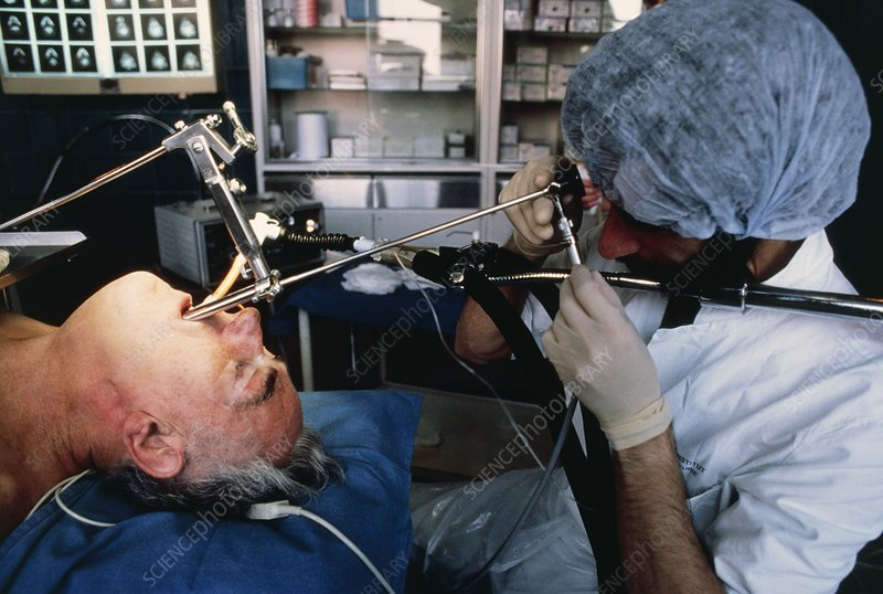 Doctor using bronchoscope to examine trachea