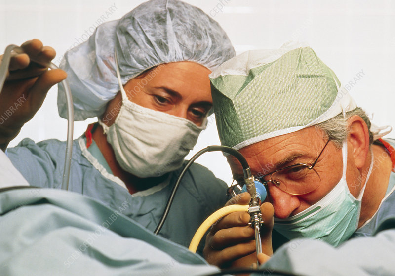 Surgeon & assistant using endoscope