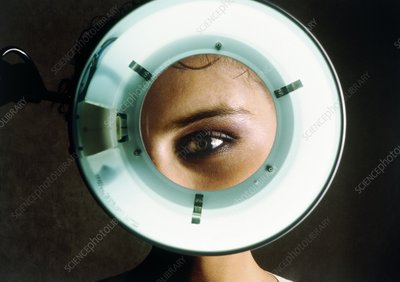 Young woman's eye magnified during eye examination
