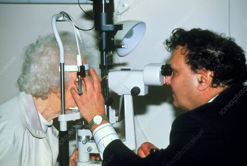Slit-lamp examination of an elderly woman's eyes