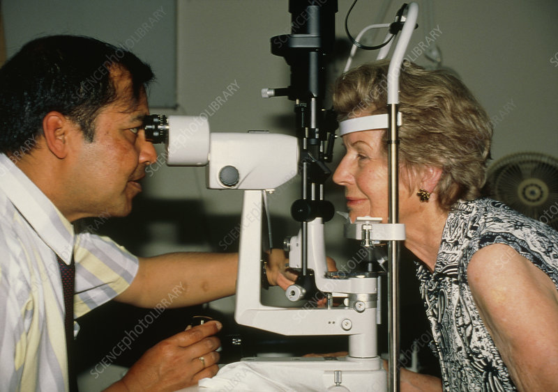 Slit-lamp examination of a woman's eyes