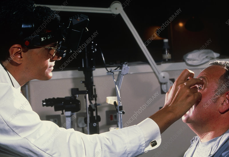 Indirect ophthalmoscope examination of a man's eye