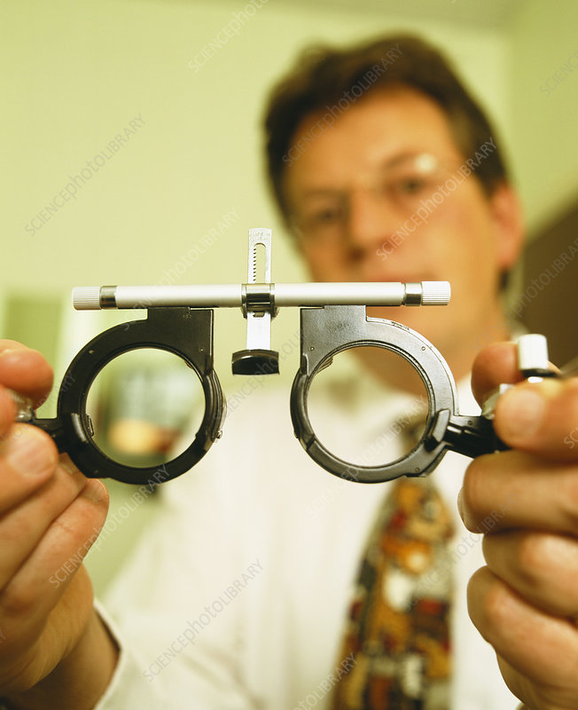Optician with eye test frames