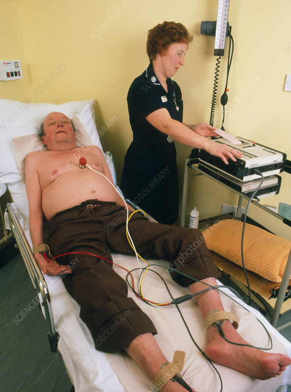 Elderly man undergoing ECG examination