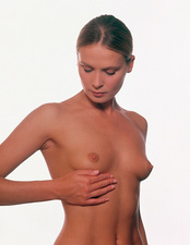Breast self-examination by a woman