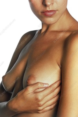 Woman palpates breast during self-examination