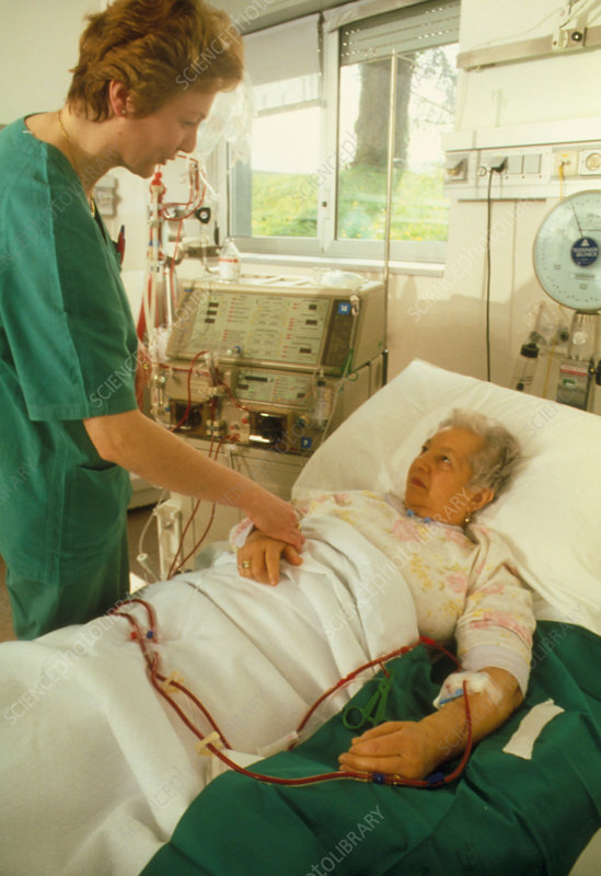 Nurse conforts a patient during kidney dialysis