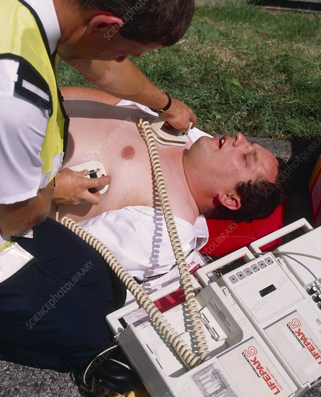 Ambulanceman treating heart patient