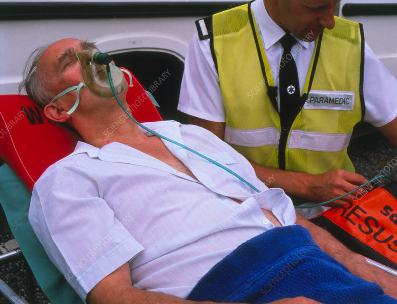 Patient being given oxygen by ambulance man