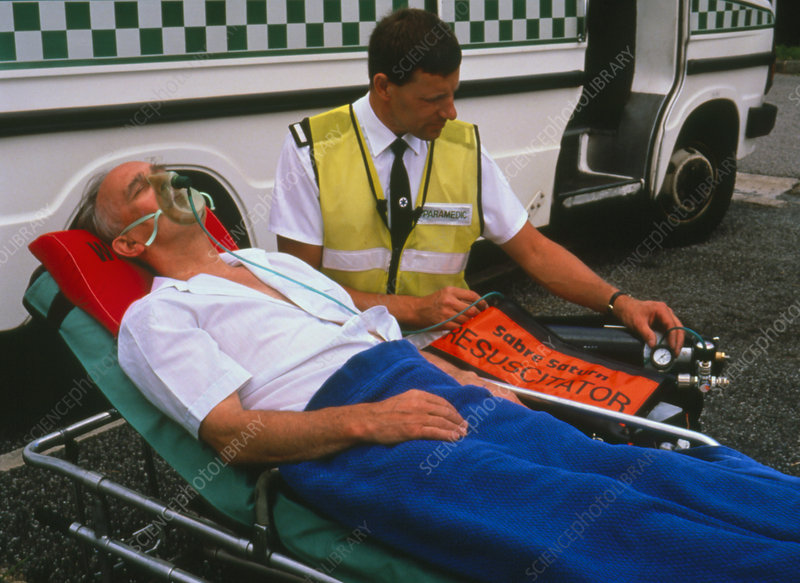 Patient being given oxygen by ambulanceman