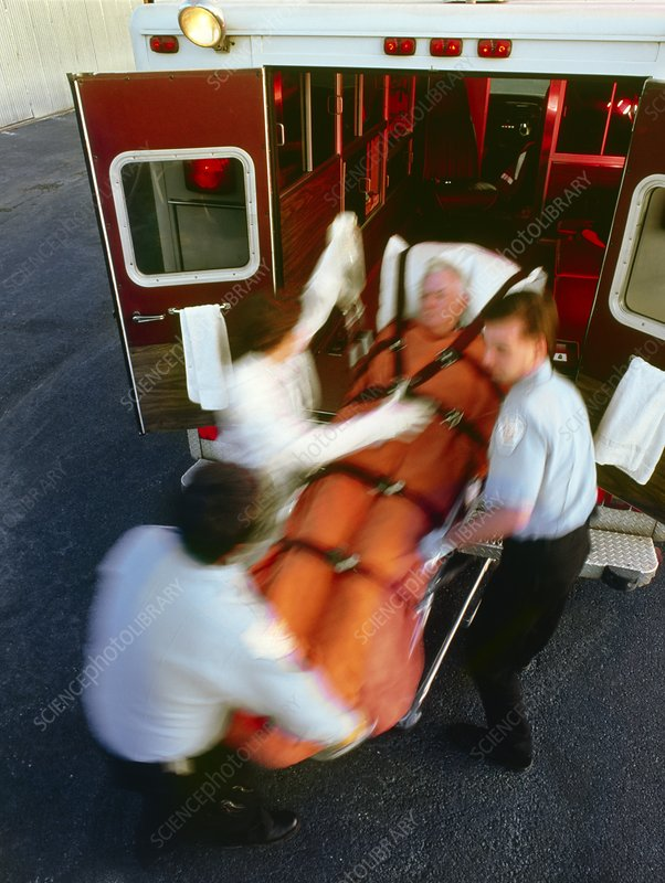 Emergency: male patient carried into ambulance