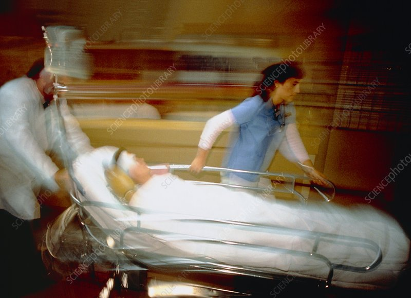 Time exposure image of a patient being moved