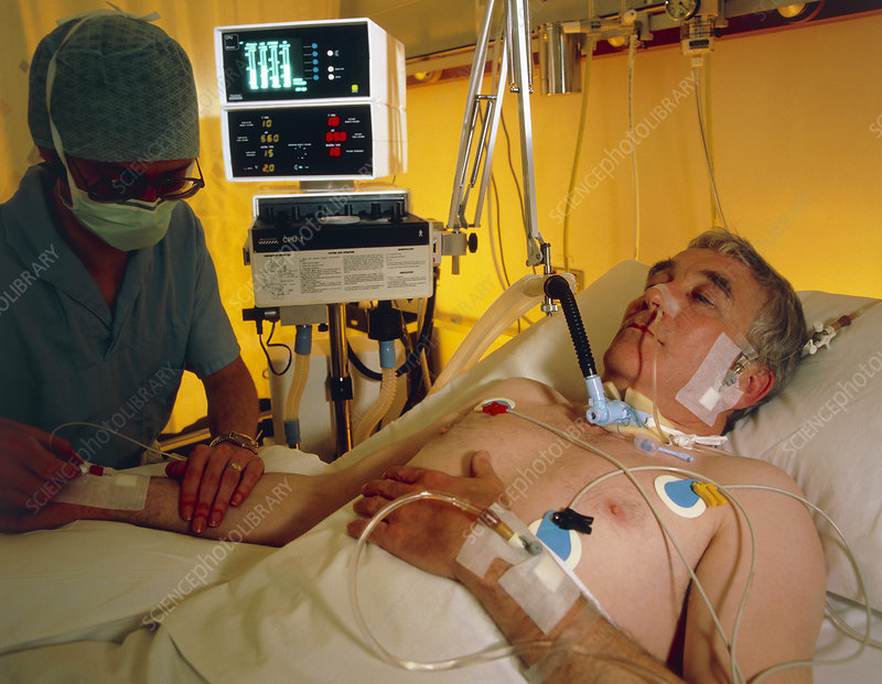 Nurse attending patient in ICU