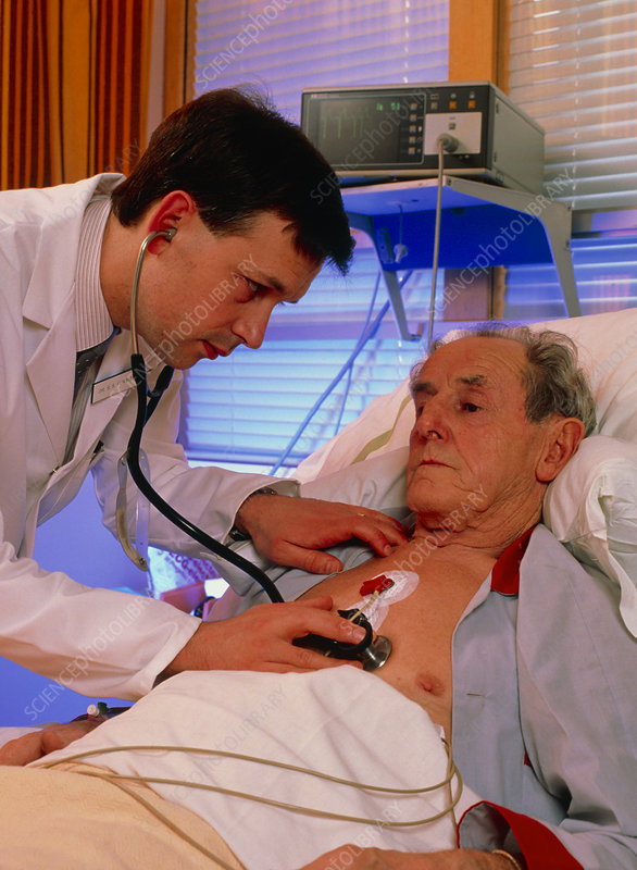 Hospital coronary care: doctor examines patient