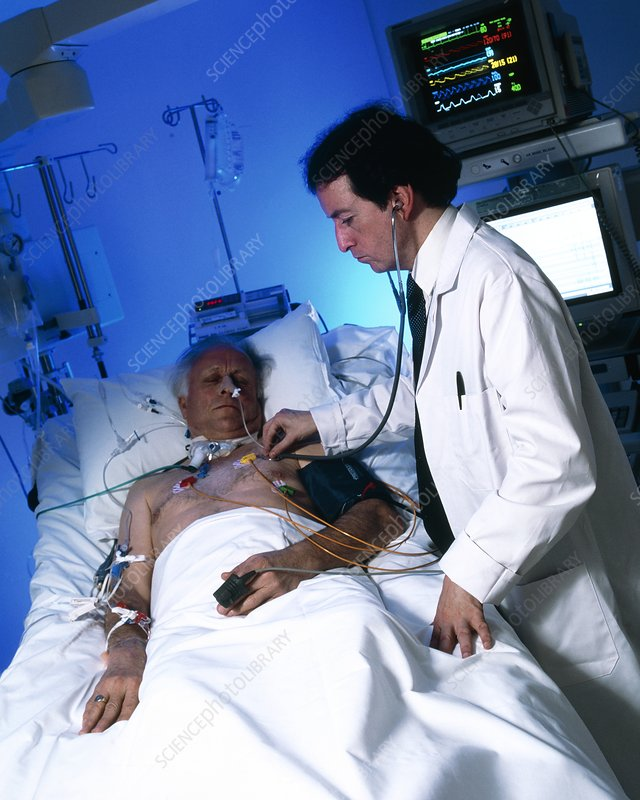 Doctor with an elderly patient in intensive care